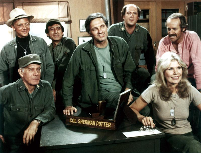 M*A*S*H (aka MASH), from left: Harry Morgan, William Christopher, Jamie Farr, Alan Alda, David Ogden Stiers, Mike Farrell, Loretta Swit, 1972-83, TM and Copyright ©20th Century Fox Film Corp. All rights reserved./courtesy Everett Collection | ©20thCentFox/Courtesy Everett Collection—©20thCentFox/Courtesy Everett Collection