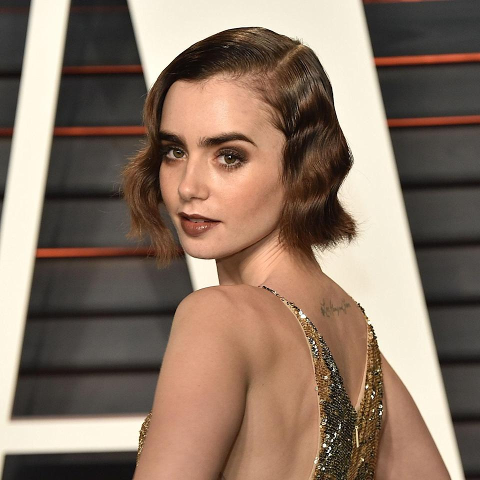 """<p><br> Lily Collins's vintage-inspired waves will never go out of style. The slightly brushed-out styling gives an unexpected take to traditional finger waves. If you're partial to a less traditional wedding dress, Adams suggests something in gold to add to the glamorous feel.</p> <p>To achieve this look, you'll need product — lots of product. """"I would say a golf ball-sized amount of <a href=""""https://www.allure.com/gallery/best-gels-for-curly-hair?mbid=synd_yahoo_rss"""" rel=""""nofollow noopener"""" target=""""_blank"""" data-ylk=""""slk:gel"""" class=""""link rapid-noclick-resp"""">gel</a> and apply it all over damp hair,"""" explains Adams. """"Comb it through to the ends of your hair until it starts to dry. Mist that section with more water and add more gel. [To create] the ridges, you need to let them dry completely before combing anything out."""" Another approach: You could get a similar look using a flatiron to create flat waves, or """"completely cheat"""" and try using a wave tool like the Best of Beauty-winning <a href=""""https://www.allure.com/gallery/best-of-beauty-makeup-brush-hot-tool-winners?mbid=synd_yahoo_rss"""" rel=""""nofollow noopener"""" target=""""_blank"""" data-ylk=""""slk:Trademark Beauty Babe Waves iron"""" class=""""link rapid-noclick-resp"""">Trademark Beauty Babe Waves iron</a>.</p>"""