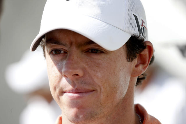 Golfer Rory McIlroy gives a television interview on the 10th tee during the pro-am round of the BMW Championship golf tournament at Conway Farms Golf Club in Lake Forest. Ill., Wednesday, Sept. 11, 2013. (AP Photo/Charles Rex Arbogast)