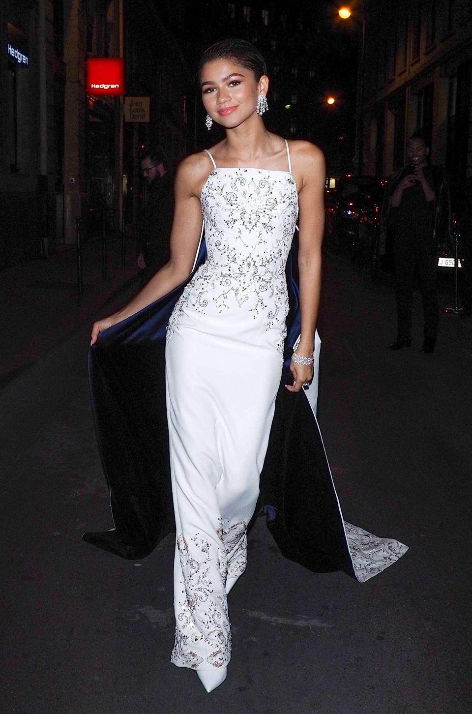 <p>Zendaya attended Ralph & Russo's after-party during haute couture fashion week in Paris wearing a caped embroidered gown. <em>[Photo: Getty]</em> </p>