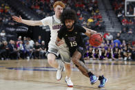 Washington's Marcus Tsohonis (15) drives around Arizona's Nico Mannion during the first half of an NCAA college basketball game in the first round of the Pac-12 men's tournament Wednesday, March 11, 2020, in Las Vegas. (AP Photo/John Locher)