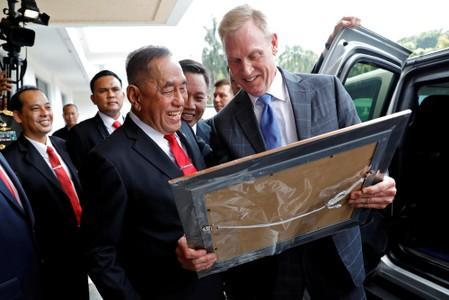 U.S. Defense Secretary Patrick Shanahan receives a gift from his Indonesian counterpart Ryamizard Ryacudu after their meeting in Jakarta