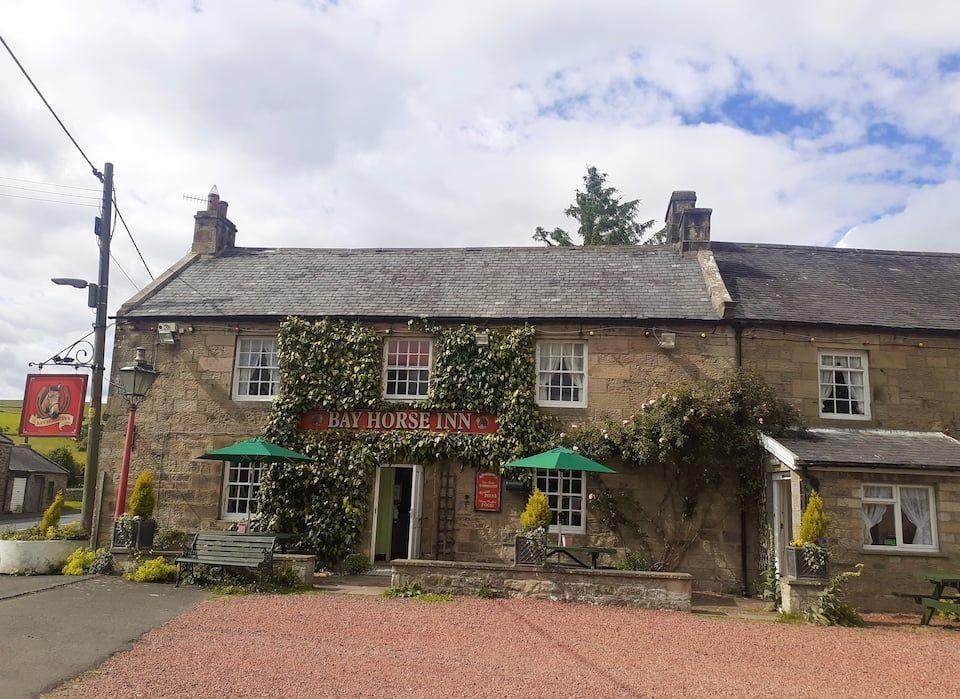 """<p>Looking for a unique staycation? This historic 18th century Coaching Inn is as charming as can be, with pretty gardens, traditional <a href=""""https://www.housebeautiful.com/uk/decorate/looks/a36342821/white-paint/"""" rel=""""nofollow noopener"""" target=""""_blank"""" data-ylk=""""slk:interiors"""" class=""""link rapid-noclick-resp"""">interiors</a> and a giant pool table. </p><p>'We are so happy to be welcoming guests back to the beautiful Northumberland National Park,' says Hilda Wright, Host at The Bay Horse Inn. 'It's been a tough year but we are grateful for the additional income that we are starting to generate through the Airbnb platform and would encourage other pub owners across the UK to open up their doors to the many Brits searching for <a href=""""https://www.housebeautiful.com/uk/lifestyle/property/a36050535/airbnb-trending-uk-locations/"""" rel=""""nofollow noopener"""" target=""""_blank"""" data-ylk=""""slk:staycations"""" class=""""link rapid-noclick-resp"""">staycations</a> on Airbnb this summer.'</p><p><a class=""""link rapid-noclick-resp"""" href=""""https://airbnb.pvxt.net/5bkPxn"""" rel=""""nofollow noopener"""" target=""""_blank"""" data-ylk=""""slk:BOOK NOW"""">BOOK NOW</a></p>"""