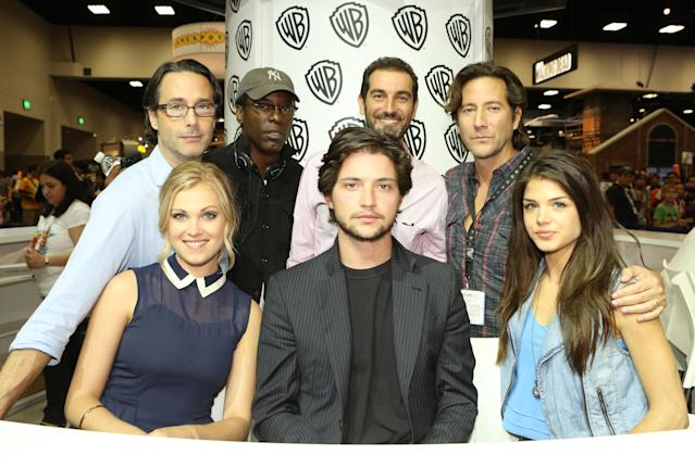 "Jason Rothenberg, Isaiah Washington, Matthew Miller, Henry Ian Cusick, Eliza Taylor, Thomas McDonell, and Marie Avgeropoulos, from The CW's upcoming ""The 100,"" at the 2013 San Diego Comic-Con International held at the San Diego Convention Center on July 19, 2013 in San Diego, California."