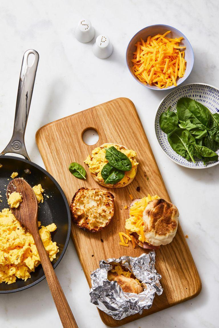 """<p>Save yourself the day-of hassle and prep these easy, microwavable sammies instead.</p><p><em><a href=""""https://www.goodhousekeeping.com/food-recipes/easy/a28639047/make-ahead-egg-and-cheese-sandwich-recipe/"""" rel=""""nofollow noopener"""" target=""""_blank"""" data-ylk=""""slk:Get the recipe for Make-Ahead Egg and Cheese Sandwiches »"""" class=""""link rapid-noclick-resp"""">Get the recipe for Make-Ahead Egg and Cheese Sandwiches »</a></em></p>"""