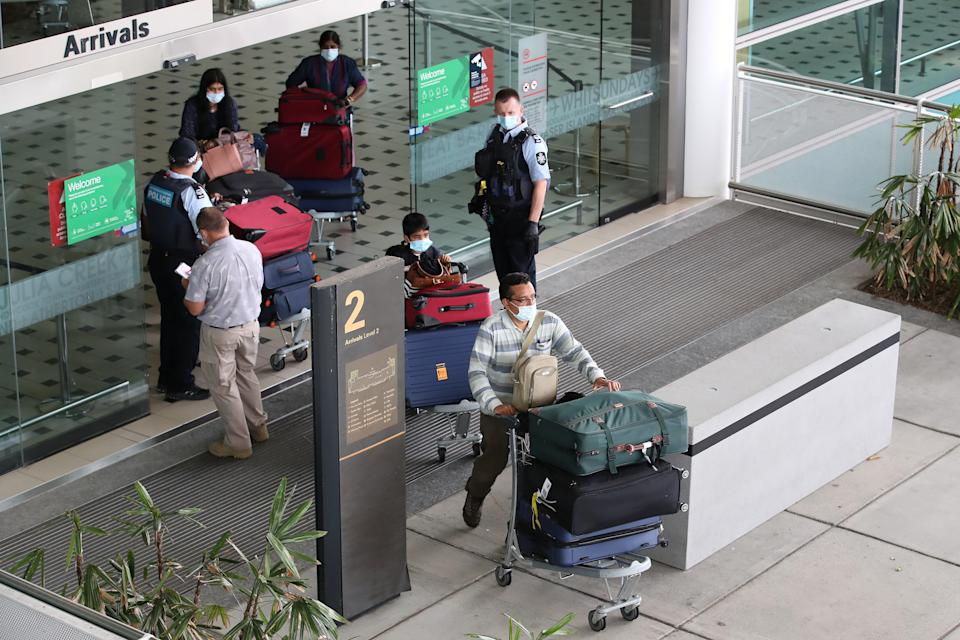 One of the new cases worked at the Brisbane International airport. Source: AAP