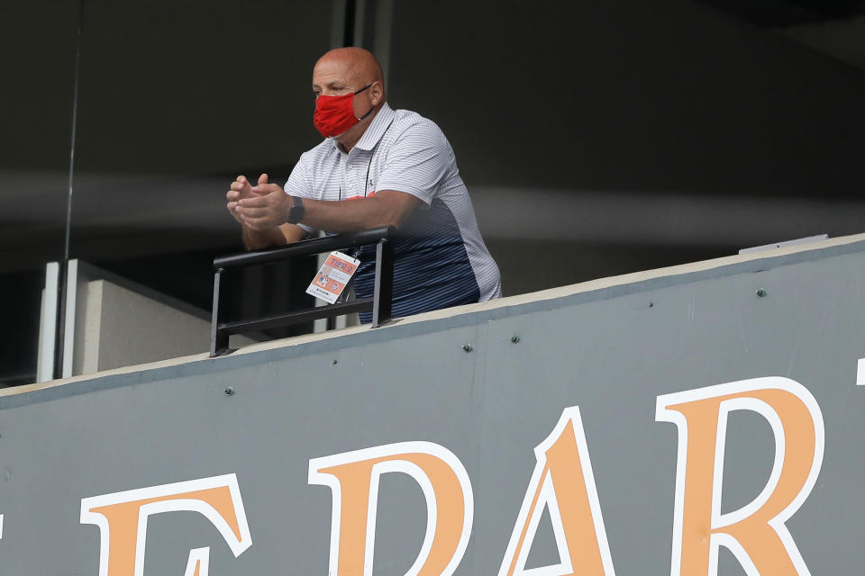FILE - In this Aug. 14, 2020, file photo, Washington Nationals general manager Mike Rizzo looks on during the seventh inning in the continuation of a suspended baseball game between the Baltimore Orioles and the Nationals in Baltimore. The entire season-opening three-game series between the Washington Nationals and New York Mets was called off on Friday, April 2, 2021, after three players for the 2019 World Series champions tested positive for COVID-19. (AP Photo/Julio Cortez, File)