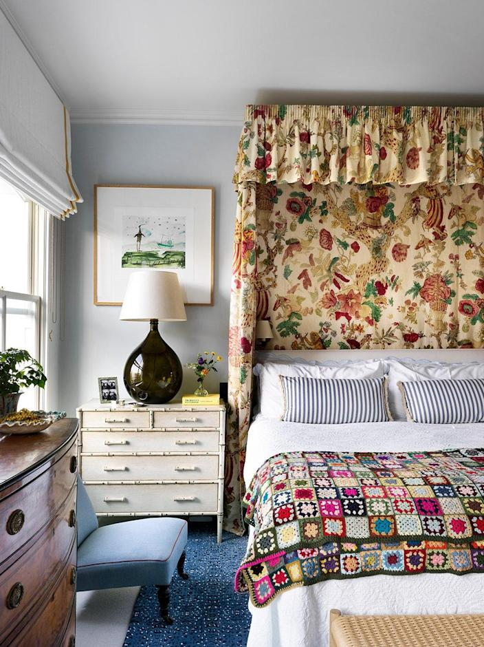 Beata doesn't shy away from color, even in the primary suite. The bold linen fabric behind the bed is called Wild Thing.