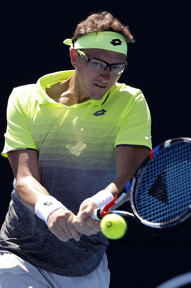 Uzbekistan's Denis Istomin makes a backhand return to Britain's Kyle Edmund during their second round match at the Australian Open tennis championships in Melbourne, Australia, Wednesday, Jan. 17, 2018. (AP Photo/Dita Alangkara)