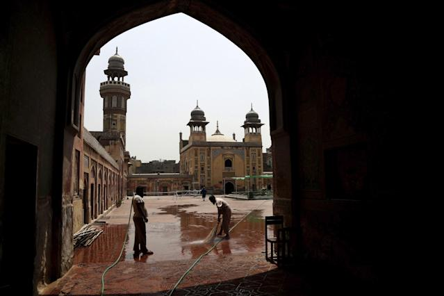 <p>Workers wash the courtyard of a mosque in preparation for Ramadan in Lahore, Pakistan, May 27, 2017. (AP Photo/K.M. Chaudary) </p>