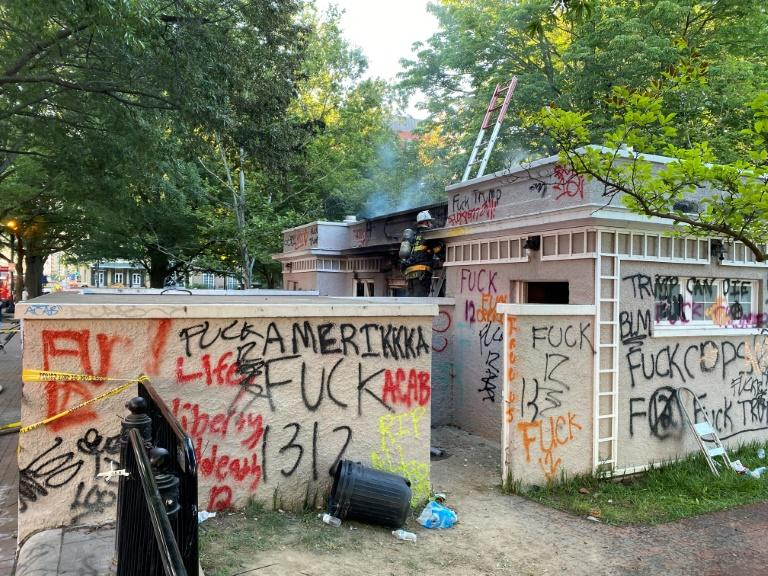 Graffiti left by demonstrators protesting the death of George Floyd is seen at Lafayette Square near the White House