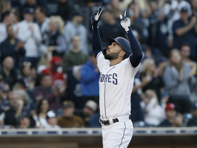 San Diego Padres' Eric Hosmer reacts after returning to the plate after hitting a solo home run against the Cincinnati Reds during the second inning of a baseball game in San Diego, Saturday, April 20, 2019. (AP Photo/Alex Gallardo)