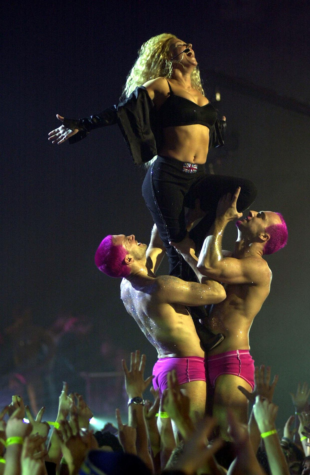 Ex-Spice Girl Geri Halliwell performing on stage during the Brit Awards 2000 ceremony, held at Earls Court in west London.