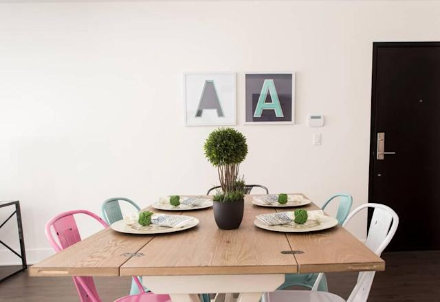 <p>Even the open-concept dining room has an <em>Alice in Wonderland</em> theme. (Airbnb) </p>