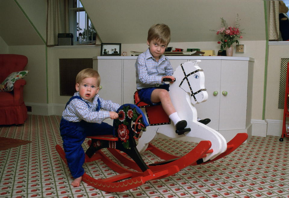LONDON, UNITED KINGDOM - OCTOBER 22:  Prince William And Prince Harry Playing On A Rocking Horse In Their Playroom At Kensington Palace  (Photo by Tim Graham/Getty Images)