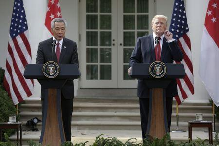 Singapore's Prime Minister Lee Hsien Loong and U.S. President Donald Trump give joint statements in the Rose Garden of the White House in Washington, U.S., October 23, 2017. REUTERS/Joshua Roberts