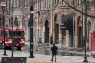 Debris scattered near the scene of an explosion in downtown Nashville, Tenn., Friday, Dec. 25, 2020. Buildings shook in the immediate area and beyond after a loud boom was heard early Christmas morning.(AP Photo/Mark Humphrey)