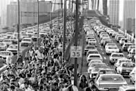 <p>New Yorkers jam the Brooklyn Bridge on their way home after a power outage shut down the subway system.</p>