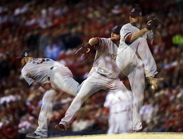 This multiple exposure photo shows Boston Red Sox starting pitcher Jon Lester throwing during the eighth inning of Game 5 of baseball's World Series against the St. Louis Cardinals Monday, Oct. 28, 2013, in St. Louis. (AP Photo/Jeff Roberson)