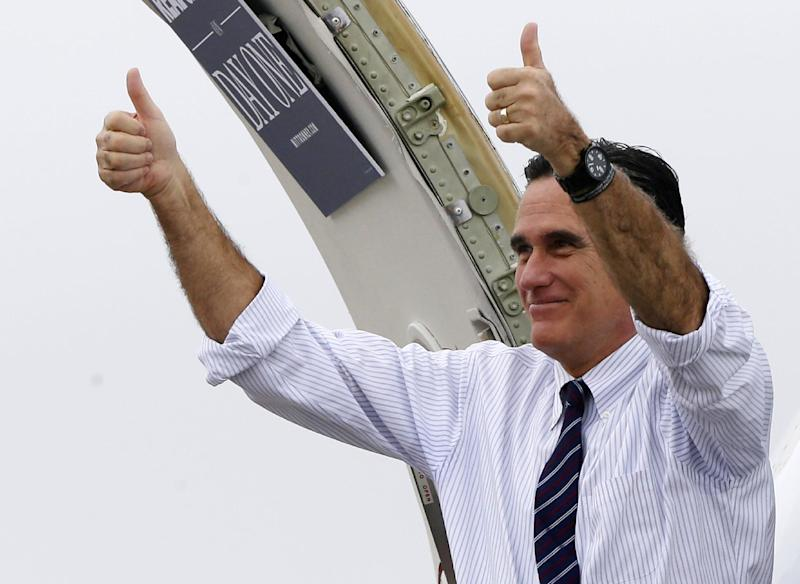 Republican presidential candidate, former Massachusetts Gov. Mitt Romney gives two thumbs up as he boards his campaign plane after a Florida campaign rally at Orlando Sanford International Airport, in Sanford, Fla., Monday, Nov. 5, 2012, enroute to Virginia. (AP Photo/Charles Dharapak)