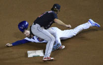 Cleveland Indians second baseman Mike Freeman (6) tags out Chicago Cubs' Ian Happ (8) at second base on a steal attempt during the seventh inning of a baseball game, Tuesday, Sept.15, 2020, in Chicago. (AP Photo/David Banks)