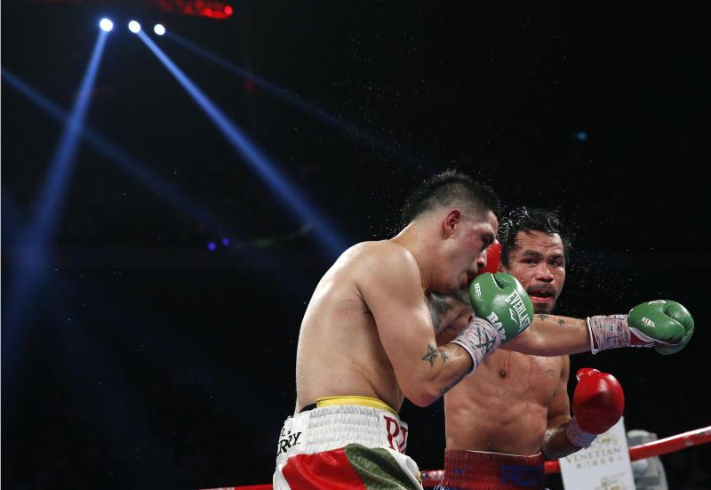Manny Pacquiao from the Philippines, right, lands a right to Brandon Rios of the United States during their WBO international welterweight title fight Sunday, Nov. 24, 2013, in Macau. Pacquiao defeated Rios by unanimous decision on Sunday to take the WBO international welterweight title and return to his accustomed winning ways after successive defeats. (AP Photo/ Vincent Yu)
