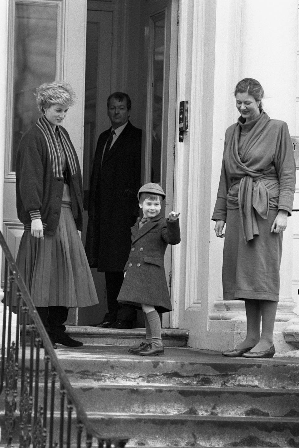 Prince William appeared fairly happy on his first day at big school, wearing the his double breasted school coat and a grey cap. His mother, the late Princess of Wales, dropped him off. <em>[Photo: PA]</em>