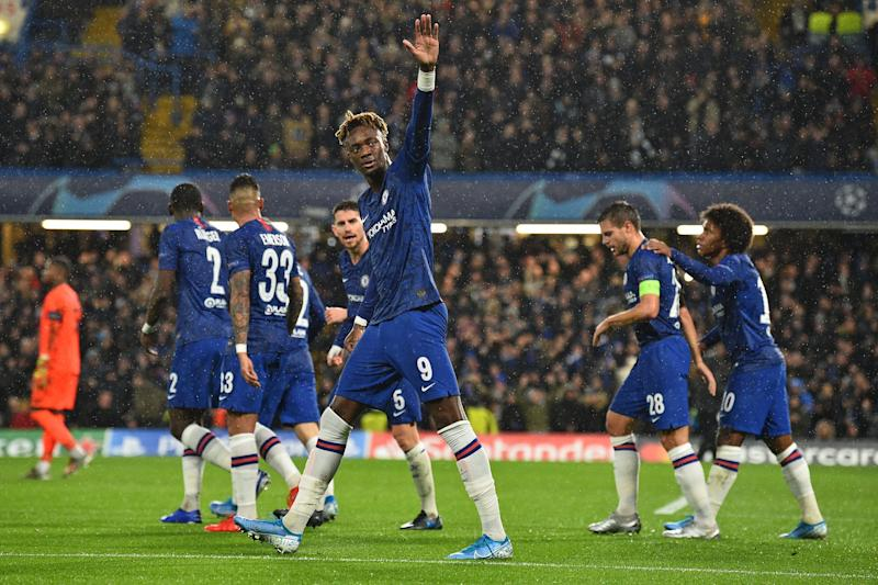 Chelsea's English striker Tammy Abraham (C) celebrates after scoring the opening goal of the UEFA Champion's League Group H football match between Chelsea and Lille at Stamford Bridge in London on December 10, 2019. (Photo by Glyn KIRK / AFP) (Photo by GLYN KIRK/AFP via Getty Images)