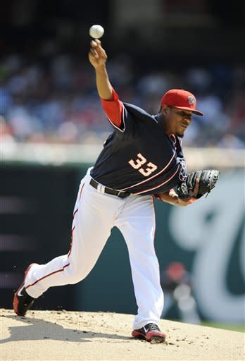 Washington Nationals starting pitcher Edwin Jackson delivers a pitch against the San Francisco Giants during the first inning of a baseball game, Wednesday, July 4, 2012, in Washington. (AP Photo/Nick Wass)