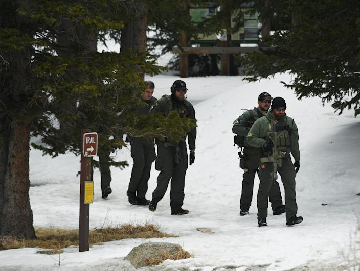 SWAT officers walk out of the woods near Echo Lake Campground in Arapaho National Forest after finding the body of Sol Pais on Wednesday. (Photo by RJ Sangosti/The Denver Post)