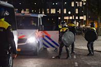 EINDHOVEN, NETHERLANDS - JANUARY 24: Riot police are seen near Eindhoven Central Station on January 24, 2021 in Eindhoven, Netherlands after a forbidden protest against the coronavirus measures turned into riots. Police cleared the area in and around Central Staition after rioters looted a supermarket and set fire to a car. (Photo by Joris Verwijst/BSR Agency/Getty Images)