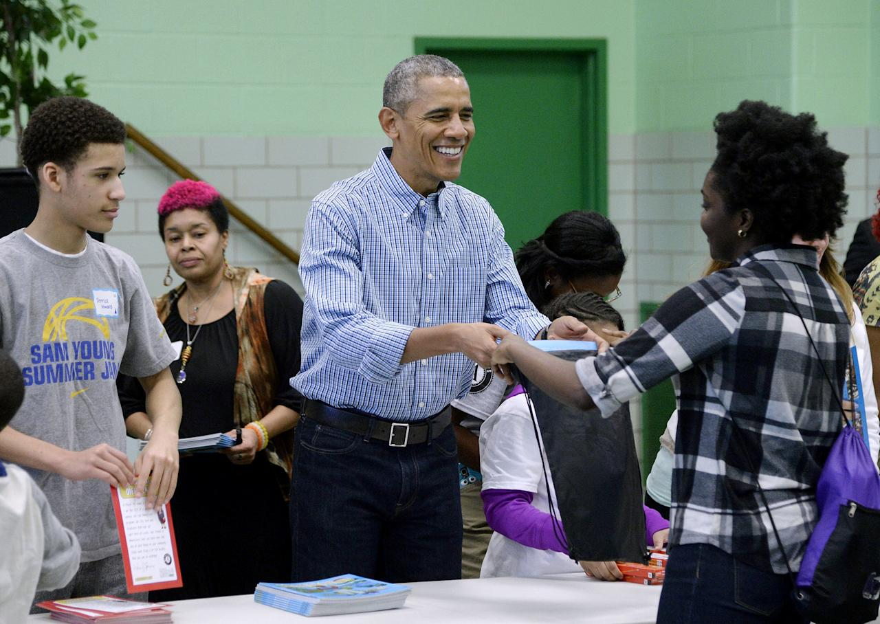 WASHINGTON, DC - JANUARY 18:  (AFP OUT) U.S. President Barack Obama participates in a community service project at Leckie Elementary school in celebration of the Martin Luther King, Jr. Day of Service and in honor of Dr. King's life and legacy on January 18, 2016 in Washington, DC. (Photo by Olivier Douliery-Pool/Getty Images)