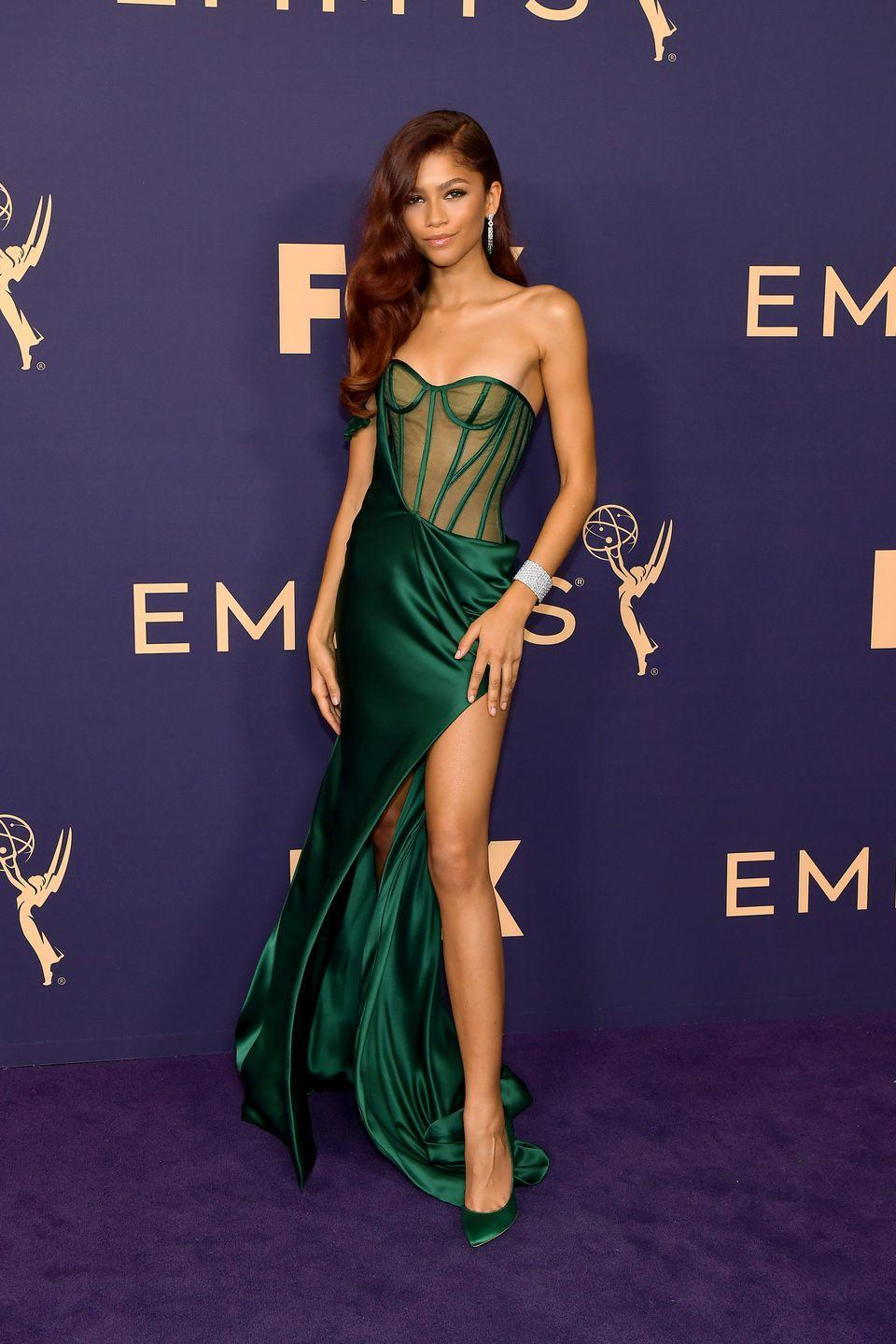 <p>Zendaya is all superstar in a green corset gown custom made by Vera Wang, with one-shoulder detail and an ultra-high slit. The actress' red hair is giving us major Poison Ivy vibes.</p>