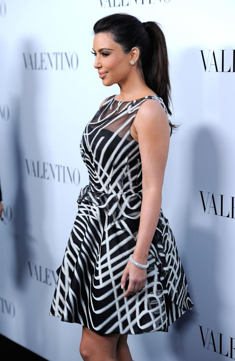 BEVERLY HILLS, CA - MARCH 27: Televison Personality Kim Kardashian arrives at Valentino Rodeo Drive Flagship store opening on March 27, 2012 in Beverly Hills, California. (Photo by Frazer Harrison/Getty Images)