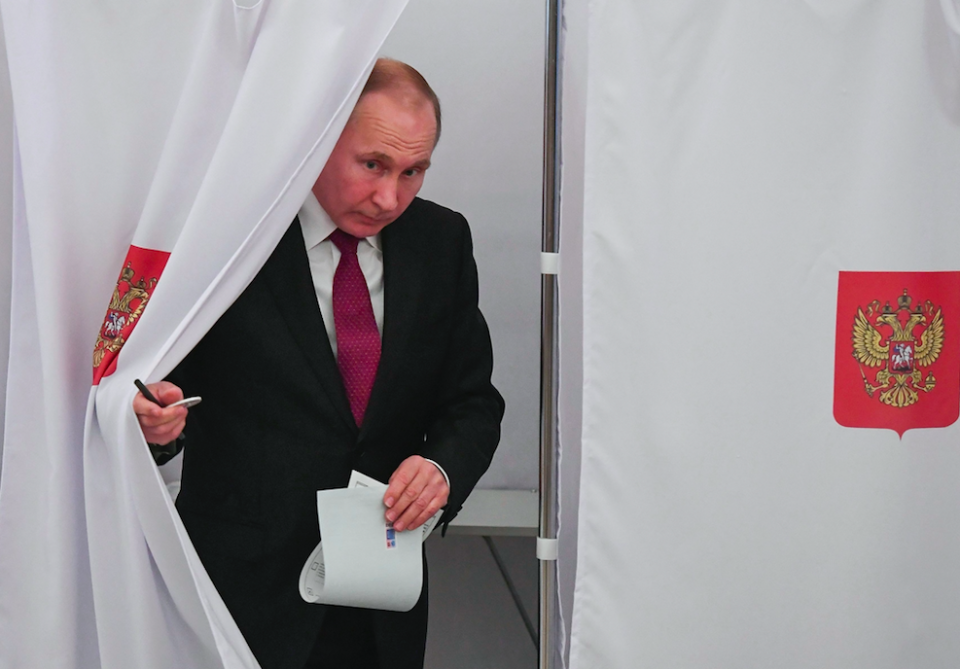 <em>Vladimir Putin casts his ballot on the day of the election (PA)</em>