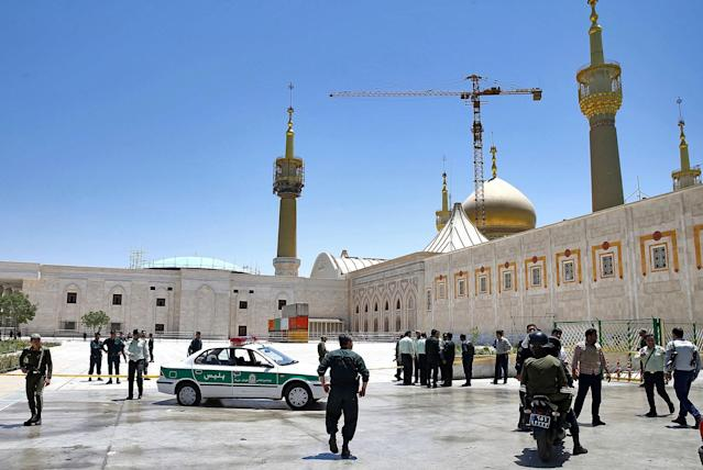 <p>Police officers control the scene, around the shrine of late Iranian revolutionary founder Ayatollah Khomeini, after an assault by several attackers in Tehran, just outside Tehran, Iran, Wednesday, June 7, 2017. (Photo: Ebrahim Noroozi/AP) </p>