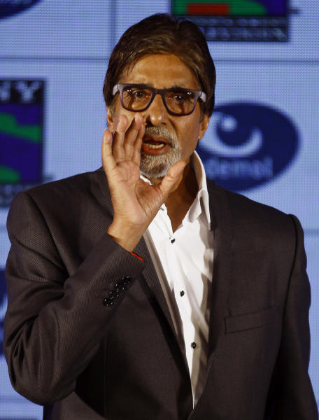 "Bollywood actor Amitabh Bachchan gestures to a photographer during a press conference in Mumbai, India, Wednesday, June 5, 2013. Bachchan, host of the popular quiz show ""Kaun Banega Crorepati"", India's version of ""Who Wants To Be A Millionaire"", is now said to produce a fiction show for the same channel. (AP Photo/Rafiq Maqbool)"