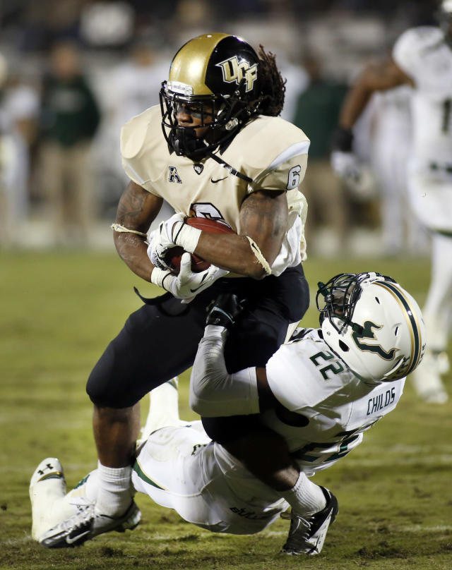 South Florida defensive back Hassan Childs (22) tackles Central Florida wide receiver Rannell Hall (6) during the first half of an NCAA college football game on Friday, Nov. 29, 2013, in Orlando, Fla. (AP Photo/Reinhold Matay