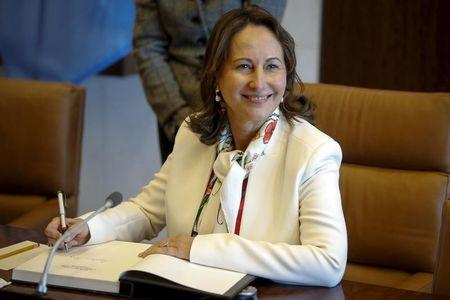 French Minister for Ecology, Sustainable Development and Energy Segolene Royal signs the guest book following her photo opportunity with United Nations Secretary General Ban Ki-moon at United Nations Headquarters in the Manhattan borough of New York