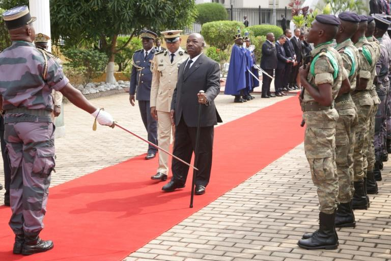 Gabon President Ali Bongo (C) made his first public appearance on Friday, nearly ten months after suffering a stroke