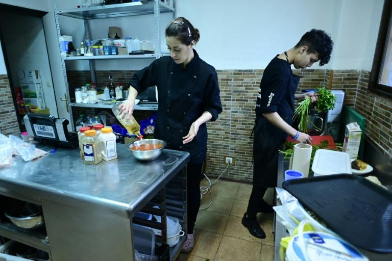 Syrian chef Hala Doudieh and her Moroccan assistant Souhaib Chabchaoui at work