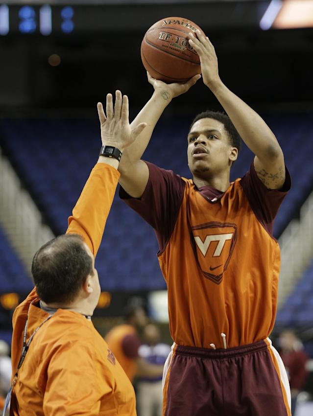 Virginia Tech's Jarell Eddie takes a shot over an assistant coach during an NCAA college basketball practice at the Atlantic Coast Conference tournament in Greensboro, N.C., Tuesday, March 11, 2014. Virginia Tech plays Miami in a first round game on Wednesday. (AP Photo/Chuck Burton)
