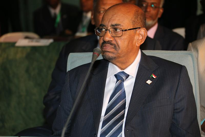 Sudanese President Omar al-Bashir, attends an African Union summit on health focusing on HIV and AIDS in Abuja, Nigeria, Monday, July 15, 2013, Angry that Nigeria is hosting a fugitive accused of genocide and war crimes, human rights lawyers Monday asked the Federal High Court to issue an arrest warrant for Sudan's leader Omar al-Bashir.Nigerian civil rights activists sent an urgent request to the International Criminal Court to refer the Nigerian government to the U.N. Security Council for failing to detain al-Bashir and surrender him to the court in The Hague for trial, said the Socio-Economic Rights and Accountability Project. (AP Photo/Sunday Aghaeze)