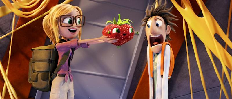 """This film image released by Sony Pictures Animation shows characters, from left, Sam Sparks, voiced by Anna Faris, Barry the Strawberry, voiced by Cody Cameron, and Flint Lockwood, voiced by Bill Hader in a scene from """"Cloudy with a Chance of Meatballs."""" (AP Photo/Sony Pictures Animation)"""