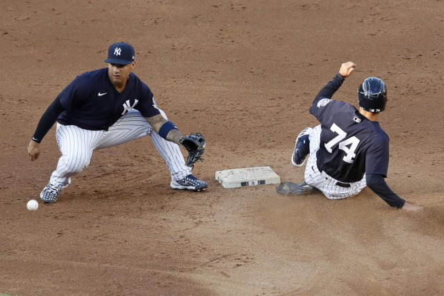 New York Yankees second baseman Gleyber Torres watis for the throw as Zack Granite slides safely into second with a stolen base during an intrasquad baseball game Wednesday, July 15, 2020, at Yankee Stadium in New York. (AP Photo/Kathy Willens)