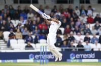 India's Rohit Sharma hits a six on a delivery by England's Ollie Robinson during the third day of third test cricket match between England and India, at Headingley cricket ground in Leeds, England, Friday, Aug. 27, 2021. (AP Photo/Jon Super)