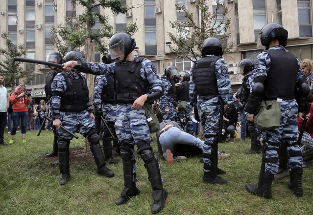 <p>Police detain protesters during a demonstration in downtown Moscow, Russia, Monday, June 12, 2017. (Pavel Golovkin/AP) </p>