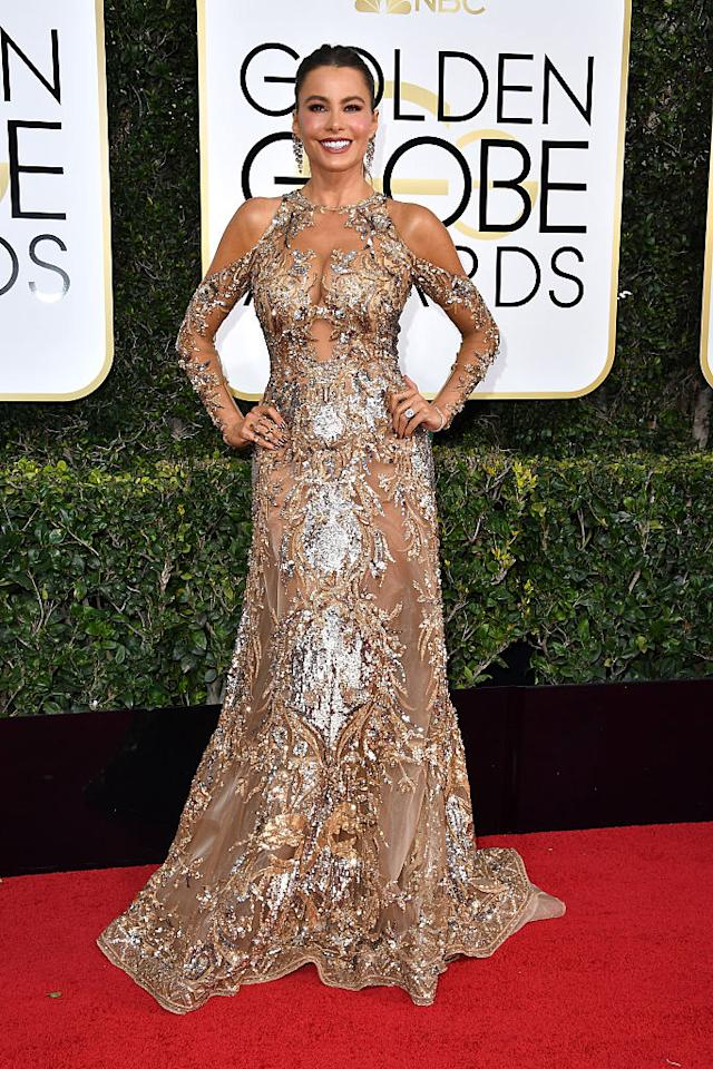 <p>At first glance Sofía Vergara might seem covered up, but look closely and you'll see that her gold gown is totally sheer. (Photo: Getty Images) </p>