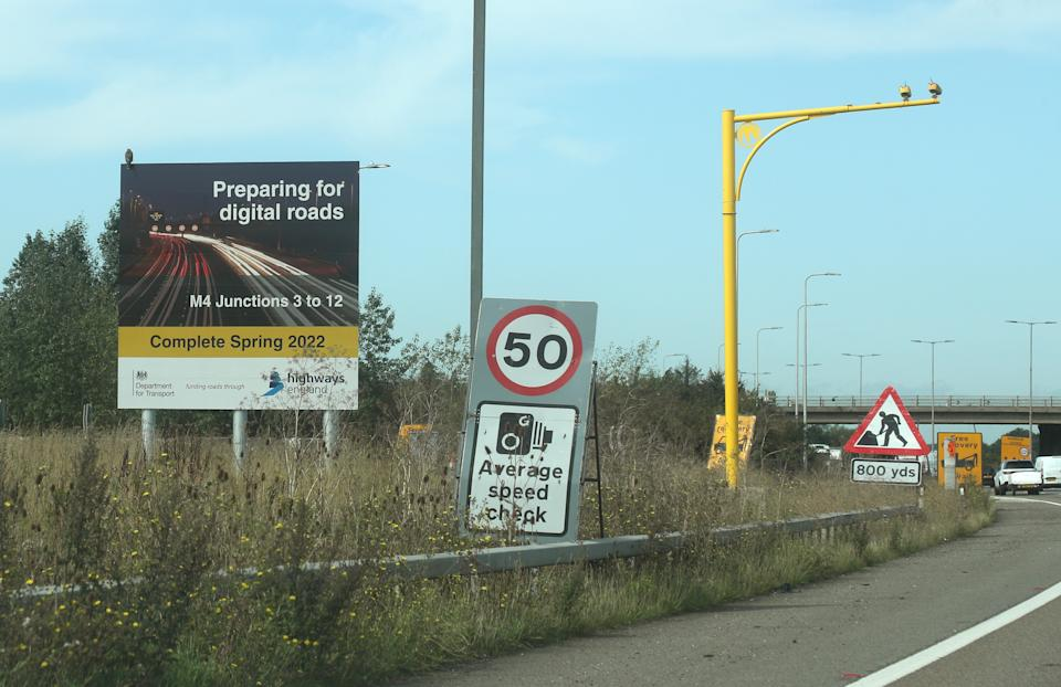 A sign announcing the forthcoming 'smart motorway' on the M4 road in Slough, Berkshire. One of the ways Highways England is increasing capacity is by creating smart motorways.