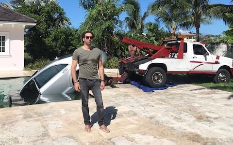 Guy Gentile poolside in the Bahamas as workers pull hit car out of the water - Credit: Guy Gentile